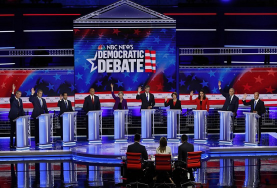 Candidates raise hands at the first U.S. 2020 presidential election Democratic candidates debate in Miami, Florida, U.S.,
